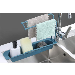 Expandable shelf for the sink