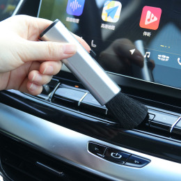 Adjustable cleaning brush for car interior
