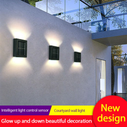 Solar wall light up and down
